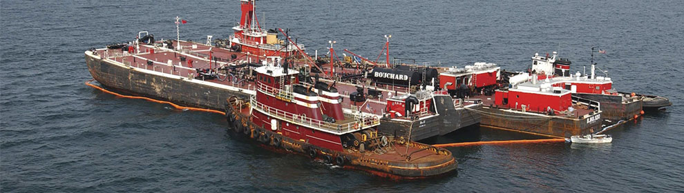 Tug boats assist in the response to Bouchard Barge No. 120.
