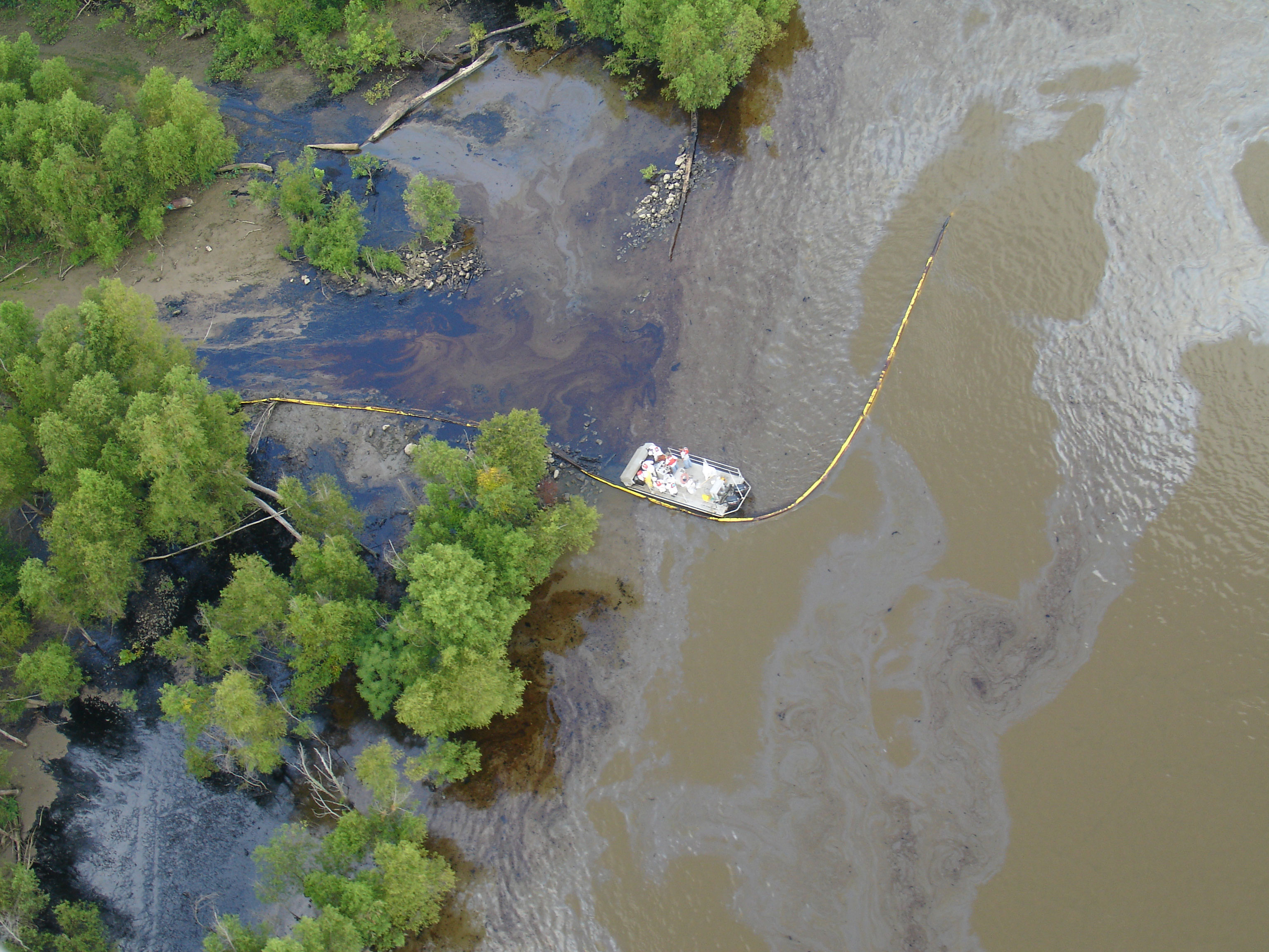 Two days after the spill occurred, oil had spread nearly 100 miles downriver, and carried into forested batture habitat.