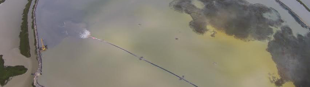 Aerial view of sediments from the Gulf Intracoastal Waterway being pumped almost six miles via pipeline into Pierce Marsh (Photo: John Morris of Mike Hooks, Inc.)