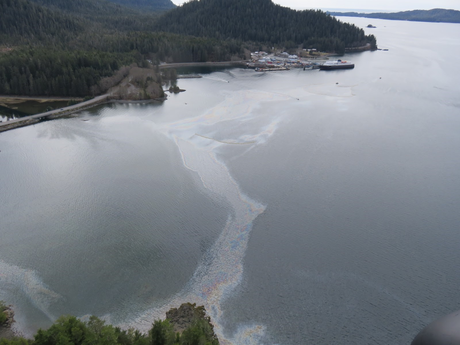 Oil sheen, containment boom, and deflection boom in Starrigavan Bay on April 23, 2017. (Photo provided by the US Coast Guard)