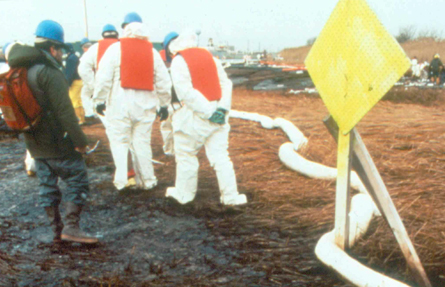 First responders set out oil sorbent pads and boom on Prall's Island in the days following the spill.
