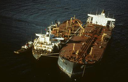 Response crews attempt to remove the remaining oil aboard the grounded tanker Exxon Valdez.
