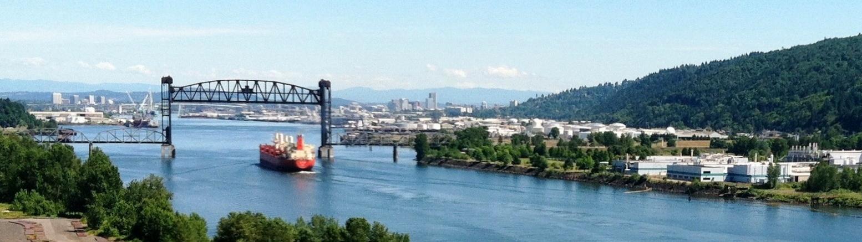 Boat under bridge across Portland Harbor