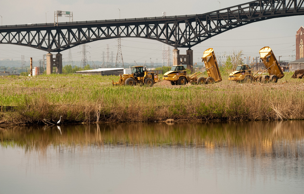 Heavy equipment removes dredge and landfill material from this site of marsh restoration in Lincoln Park, New Jersey.