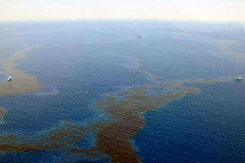 Coast Guard boats skimming surface oil from Shell Green Canyon oil spill site