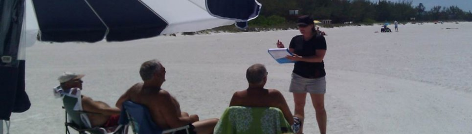 An assessment contractor interviewing beach goers about public recreation losses after the Deepwater Horizon oil spill.
