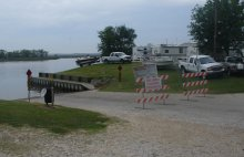 Closed boat ramp and idle boats and campers due to oil spill.