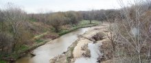 A creek runs through an autumn landscape where restoration may happen for the 68th Street superfund case.