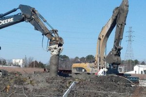 In Situ Soil Treatment with earth movers at Atlantic Wood Industries site.