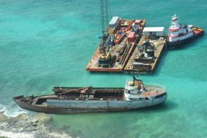 Response barges are anchored near the M/V Jireh. (USCG)